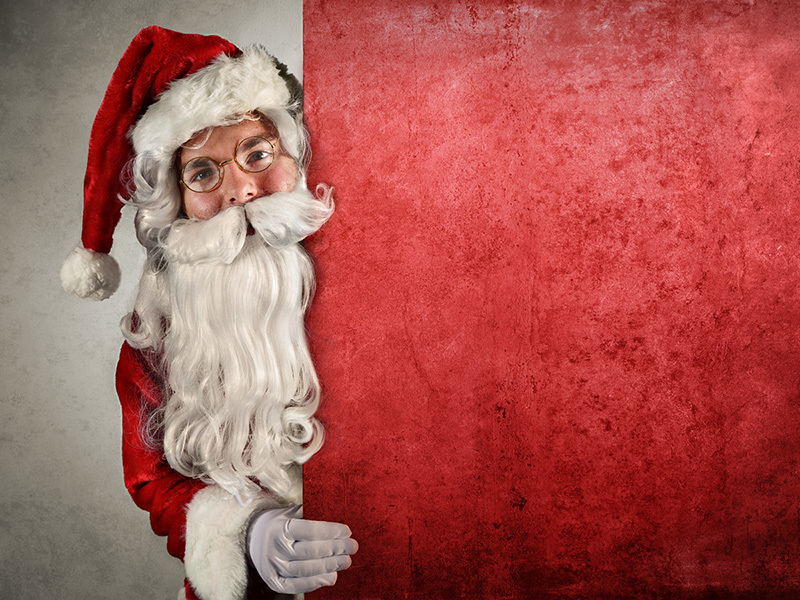 Santa Claus Showing Behind Of Billboard