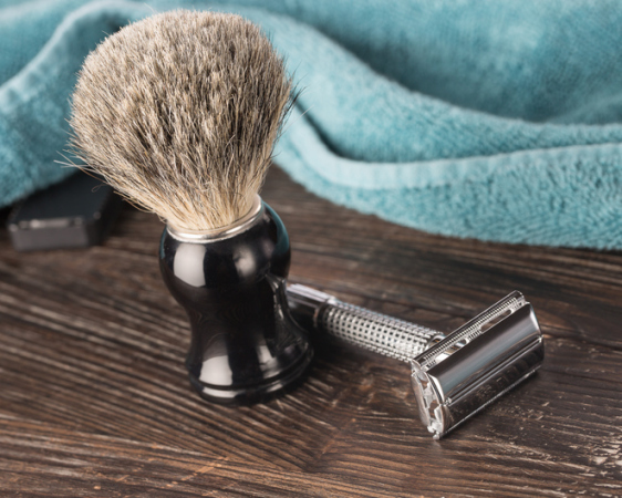 Double edged razor in bathroom setting for a wet shave